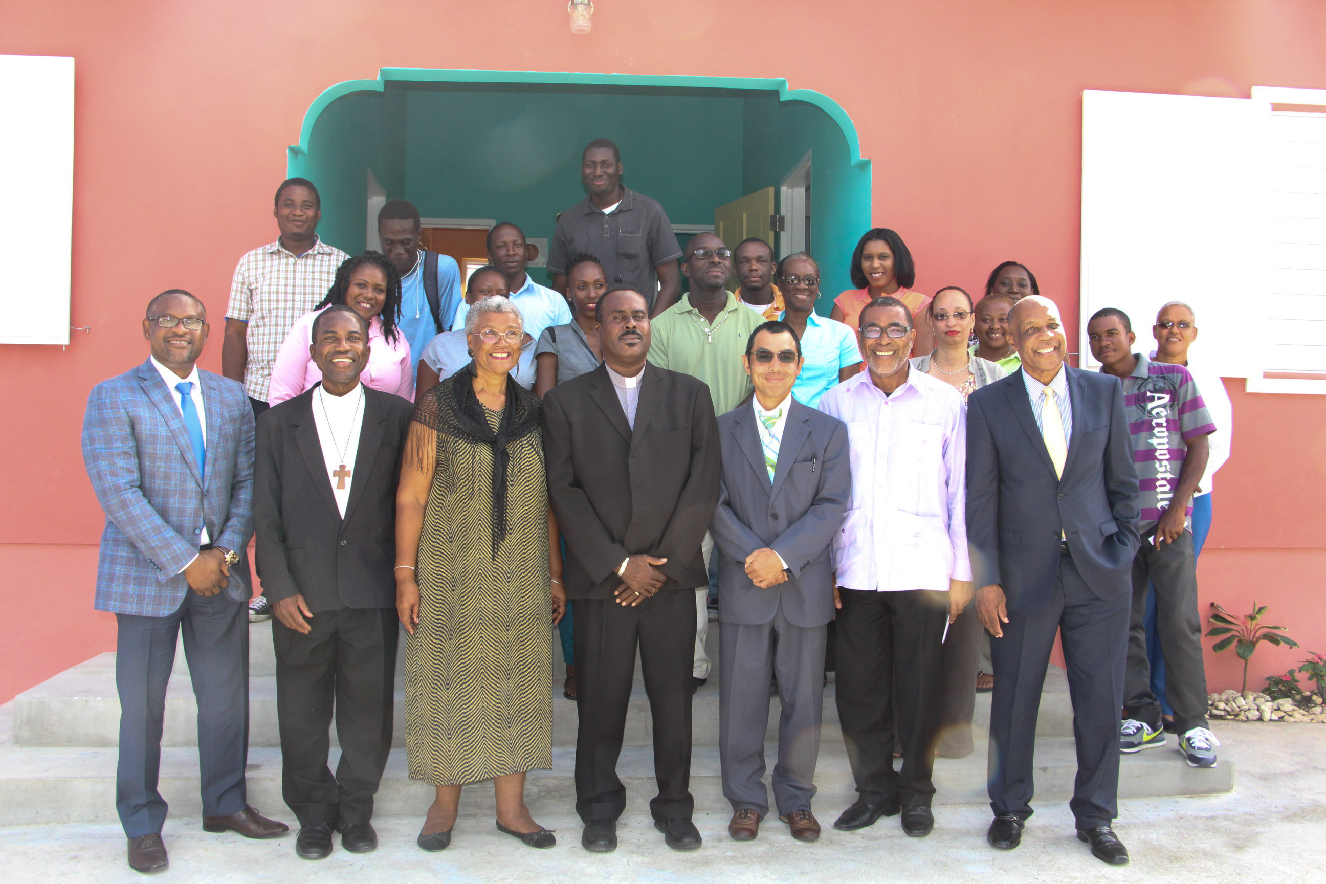 Group photo with staff, participants and invited guests